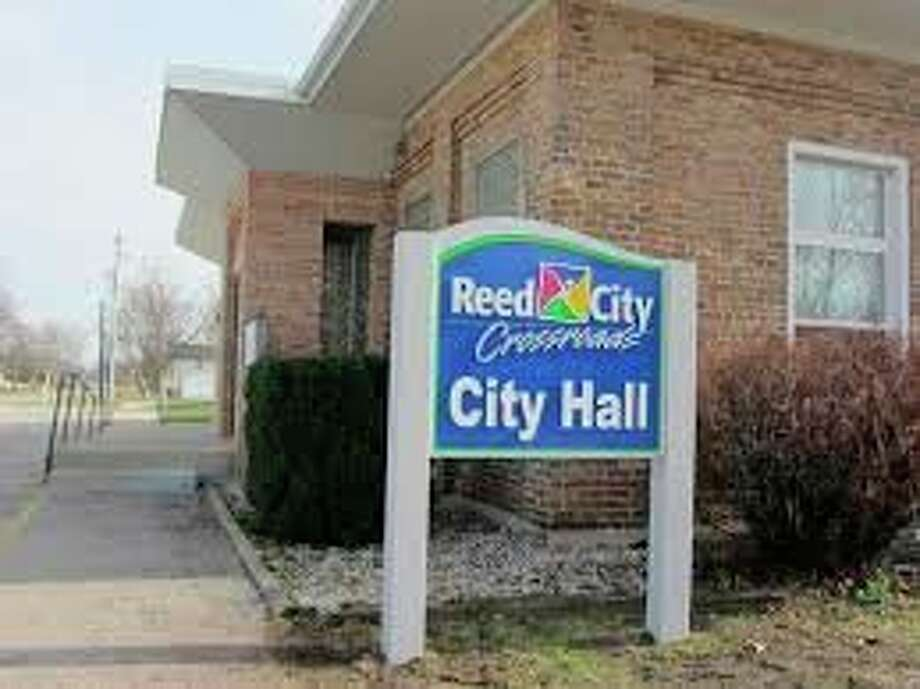 Reed City city hall has reopened to the public under a new safety plan which limits visitors and encourages residents to continue to use online bill pay and the drop box. (Herald Review file photo)