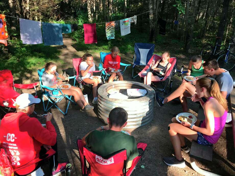 Benzie Central cross country coaches and runners enjoy pasties at their campsite during leadership camp in Michigan's Upper Peninsula last week. (Submitted photo)