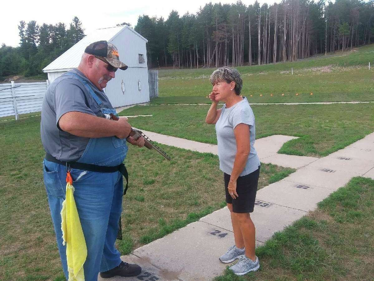 Trapshooting expert Nora Ross (right) instructs Mark Curtiss on the proper gun fit during a clinic last Thursday at the Reed City Sportsman Club. (Courtesy photo)