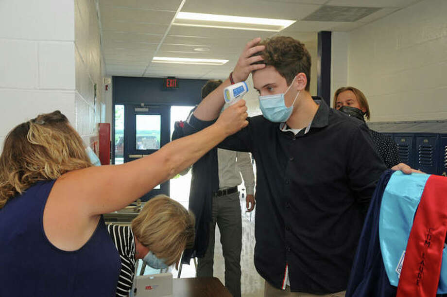 Josh McGuire has his temperature checked prior to the start of the Jerseyville High School graduation.