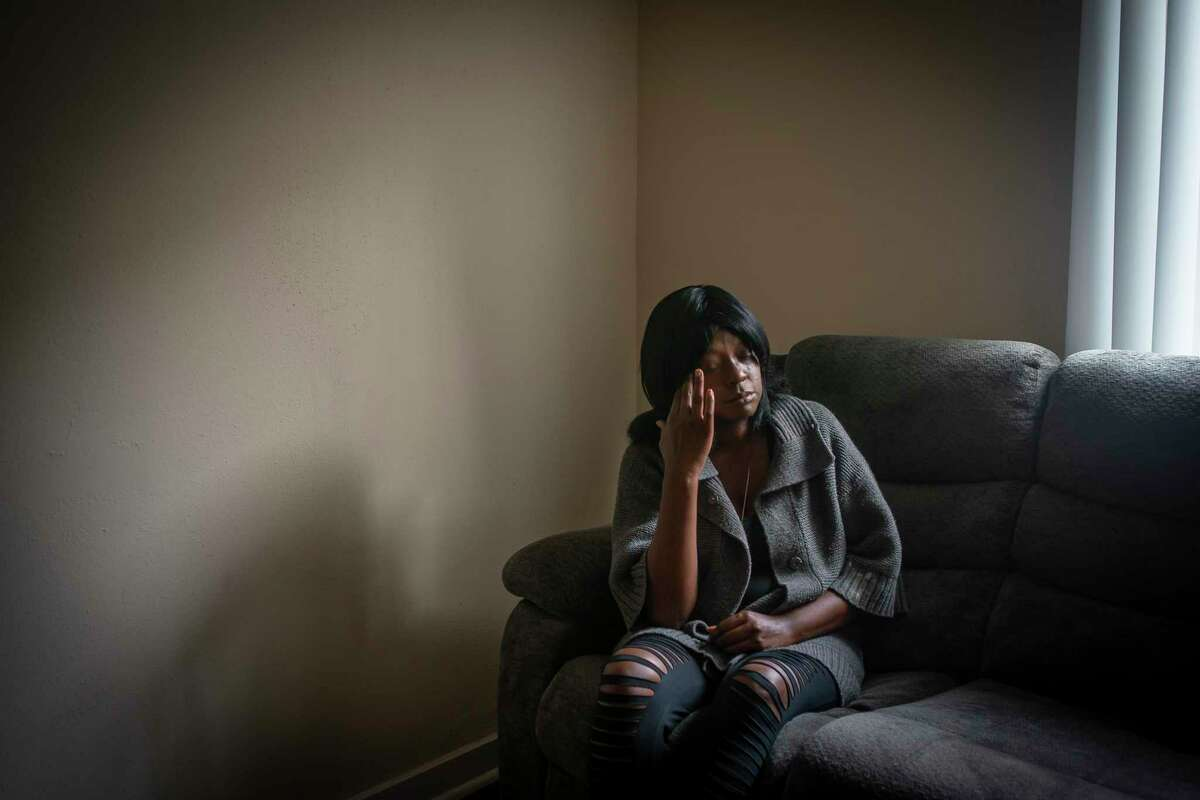 Lylian Walk speaks from inside her apartment. She is struggling to pay rent after losing her job earlier this year. Photographed Tuesday, May 12, 2020, in Houston.
