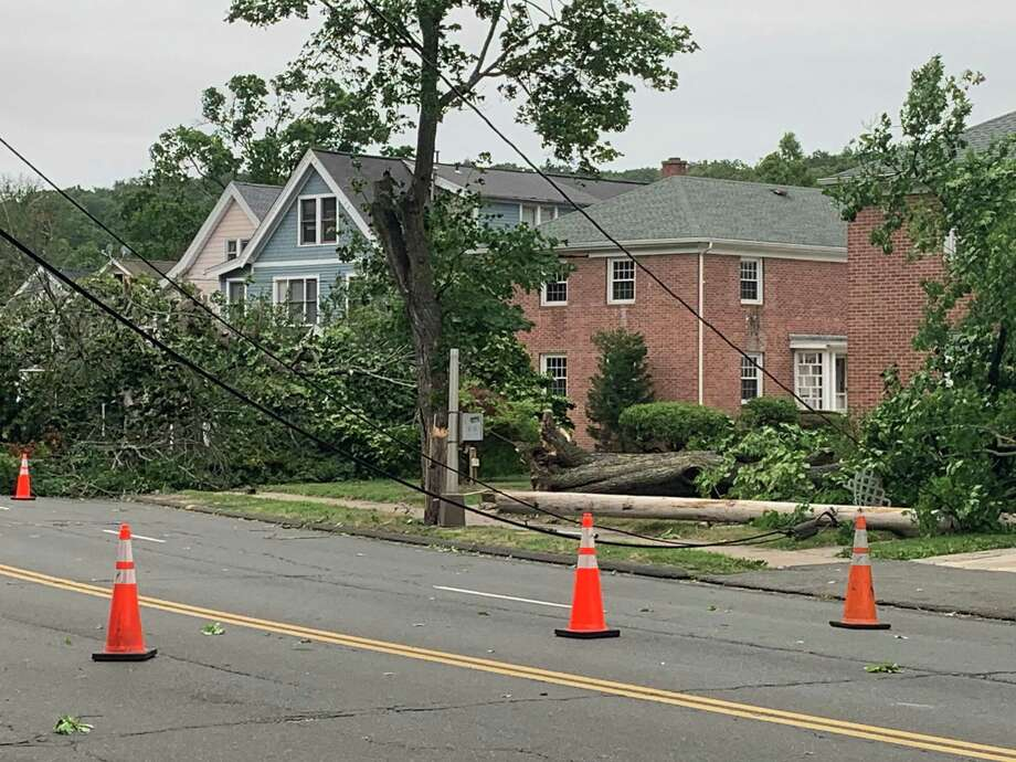 A downed tree with wires on Whitney Ave. in Hamden on Aug. 4, 2020. Photo: Sean Bowley/Hearst Connecticut Media