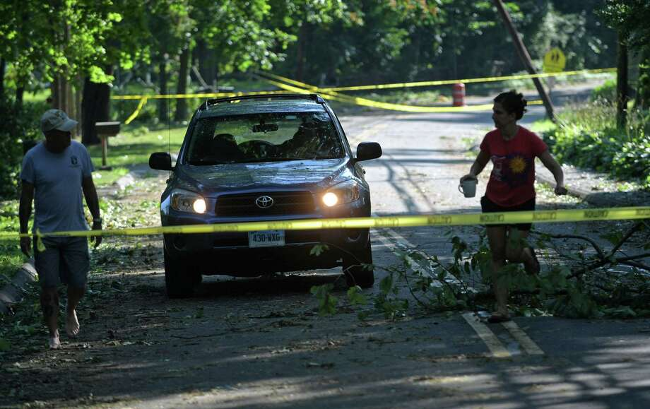 Residents on Ponus Ave emerge to find damage wrought by tropical storm Isaias Wednesday, August 5, 2020, which brought down trees with wind gusts up to 70 miles per hour in Norwalk, Conn. Photo: Erik Trautmann / Hearst Connecticut Media / Norwalk Hour