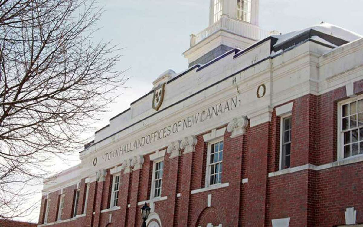 New Canaan town and school board officials met with the goal of opening more productive lines of comunication.