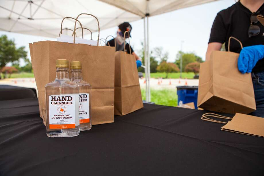 Tito's Handmade Vodka and the Houston Astros will hand out 27,000 bottles of hand sanitizer Thursday. Photo: Courtesy Tito's Handmade Vodka