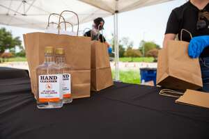 Tito's Handmade Vodka and the Houston Astros will hand out 27,000 bottles of hand sanitizer Thursday.