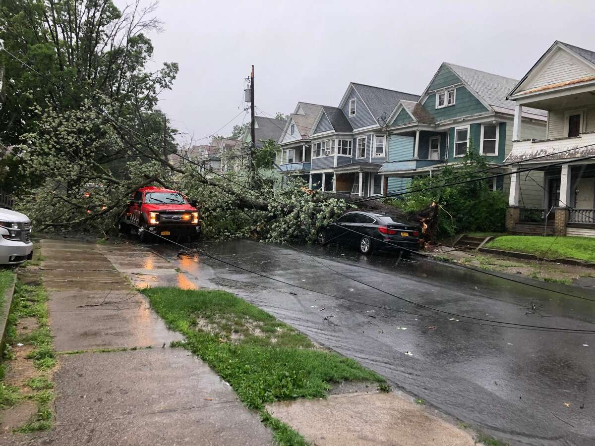 National Grid crews restored power to thousands of customers between Tuesday and Wednesday after Tropical Storm Isais dropped trees around the Capital Region Tuesday afternoon and left 50,000 of the company's customers in eastern upstate New York without power.