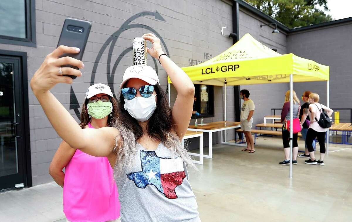 Grecia Vallejo and Luz Hernandez take a selfie at Local Group Brewing during the first ever Houston Beer Run, Saturday, August 1, 2020, in Houston. The Houston Beer Run went to five different Inner Loop locations, encouraging fans of craft beer to buy to-go beer. The Houston Beer Run is an initiative to support the craft beer industry by encouraging people to place to-go orders at local breweries.