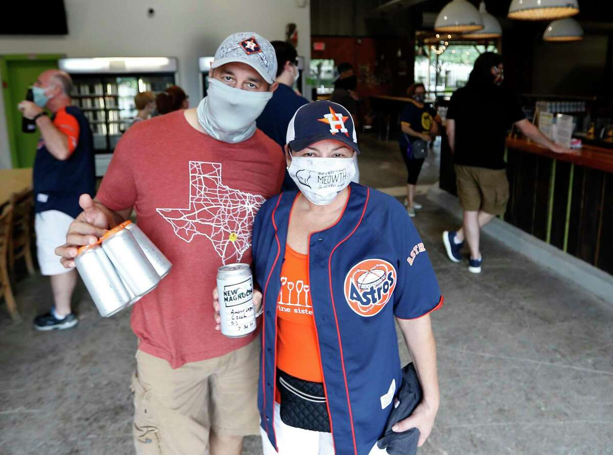 Lissa and Abel Rodriguez, of Katy with their to-go beer at New Magnolia Brewing during the first ever Houston Beer Run, Saturday, August 1, 2020, in Houston. The Houston Beer Run went to five different Inner Loop locations, encouraging fans of craft beer to buy to-go beer. The Houston Beer Run is an initiative to support the craft beer industry by encouraging people to place to-go orders at local breweries.