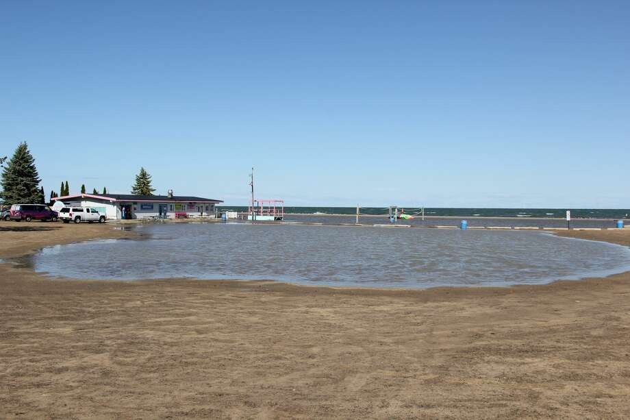 Days of heavy rain have left the beach at Caseville County Park flooded. The flooding comes as the United States Army Corps of Engineers Detroit Office said that Lake Huron's water levels reached their peak for the year. Photo: Robert Creenan/Huron Daily Tribune