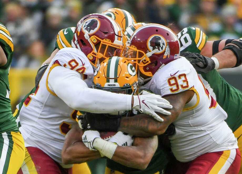 Washington nose tackle Daron Payne (94) and defensive tackle Jonathan Allen (93), shown here stuffing Green Bay Packers running back Aaron Jones (33) in a game last season, are part of a talent-laden defensive line. Photo: Washington Post Photo By Jonathan Newton / The Washington Post