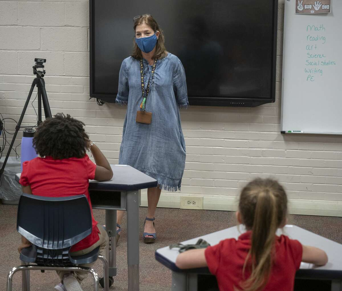 Renee Westenburg, teacher leader at Sam Houston Collegiate Prep, works with students 8/05/2020 during the first day of class. Tim Fischer/Reporter-Telegram