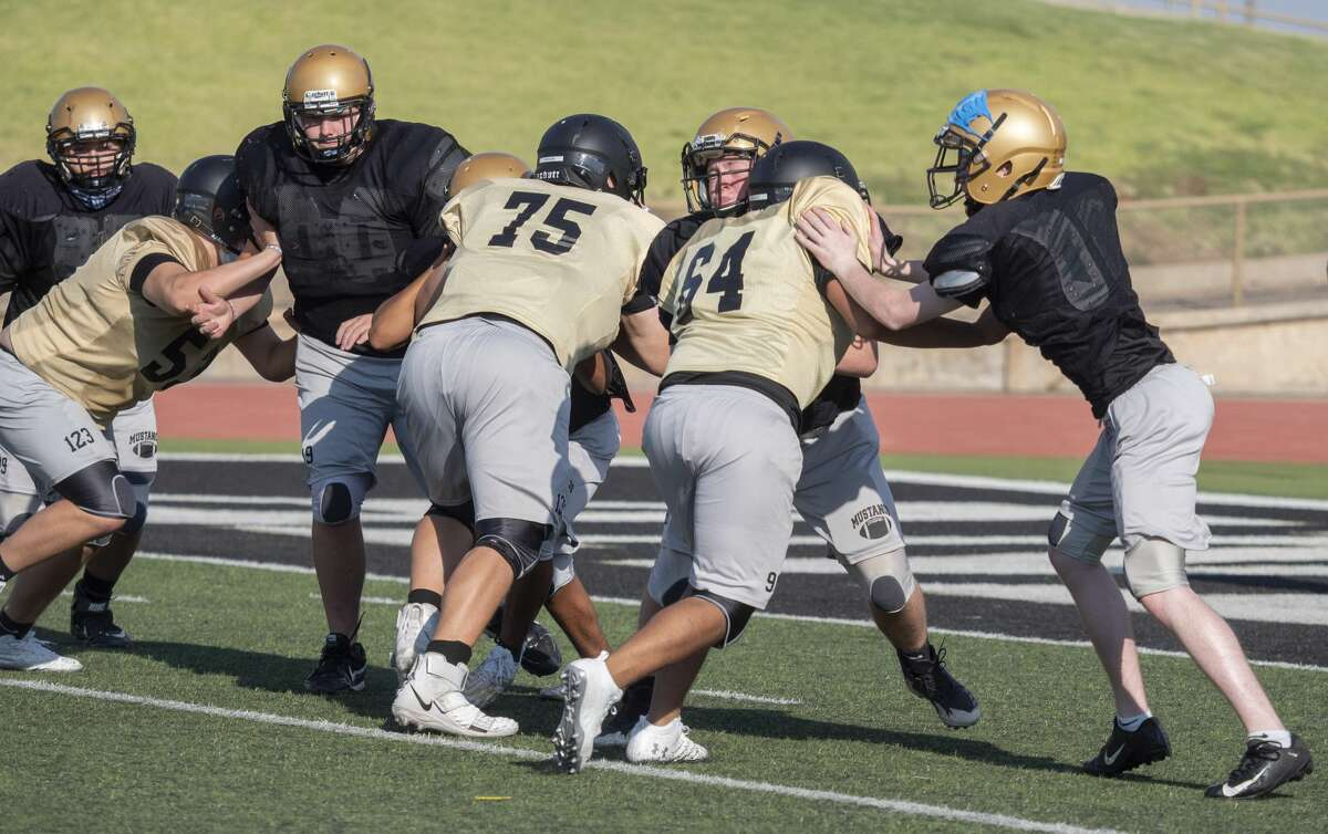 Andrews football players run drills 8/05/2020 during morning practice. Tim Fischer/Reporter-Telegram