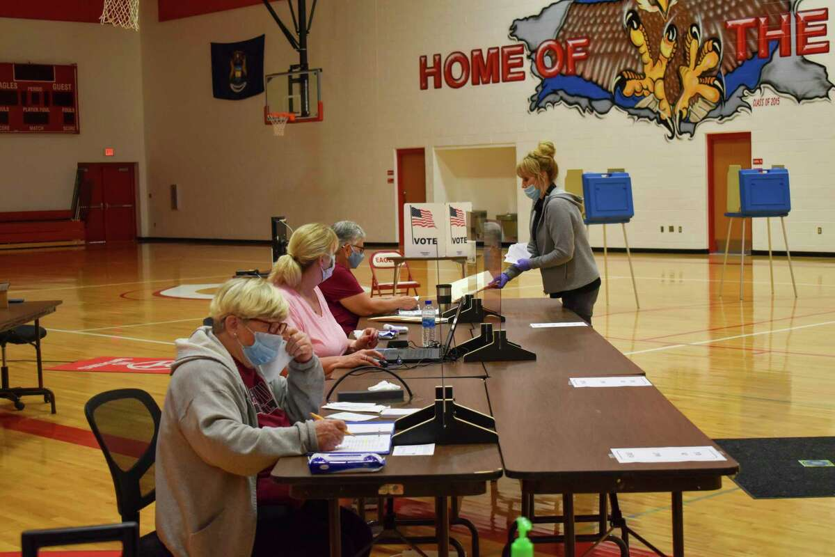 Precautions taken during the election included plexiglass barriers, masks, additional hand sanitizer, and enforced social distancing. Election workers at Caseville Public School did their best to inform the public on their requirements and make the process as easy as possible. (Paige Withey/Huron Daily Tribune)