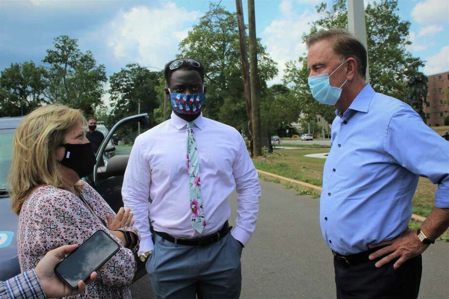 Gov. Ned Lamont, right, stopped by Middletown Wednesday afternoon on his tour of the state to view the damage caused Tuesday by Tropical Storm Isaias. He joined state Sen. Mary Abrams, D-Meriden, left, and state Rep. Quentin Phipps, D-Middletown, center. Photo: Cassandra Day / Hearst Connecticut Media