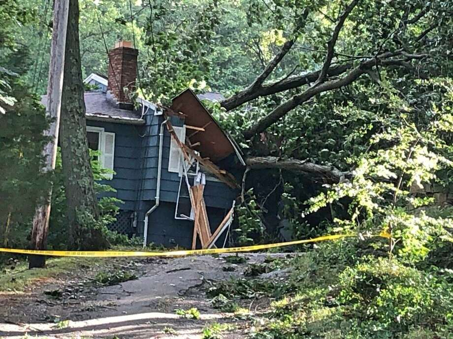 Shelton firefighters from Engine 42 rescued a family of four from the second floor of their house after a large tree crashed through the roof. There were no injuries, but the damage prevented the family from  reaching the stairs. Photo: Contributed