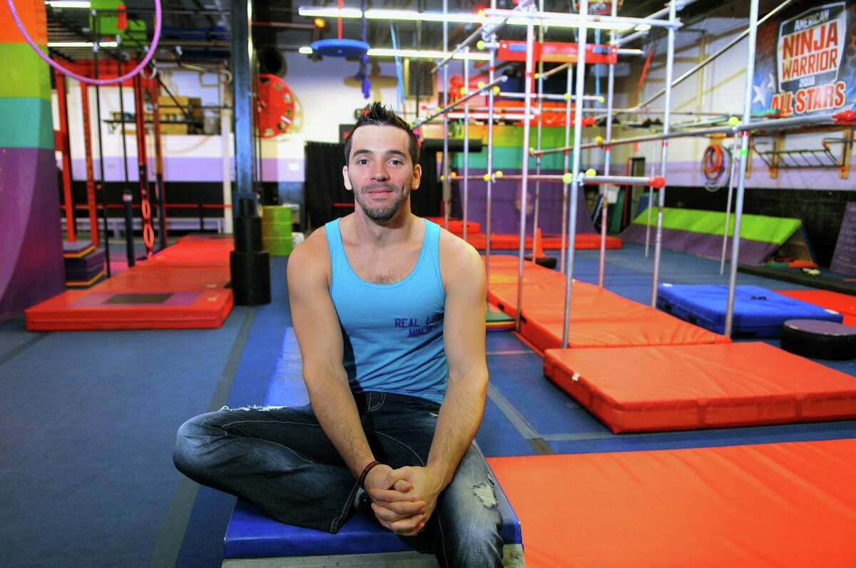 """American Ninja Warrior"" champion Drew Drechsel poses at his facility New Era Ninjas Sports & Fitness Instruction in Hamden, Conn., on Wednesday Dec. 6, 2017."