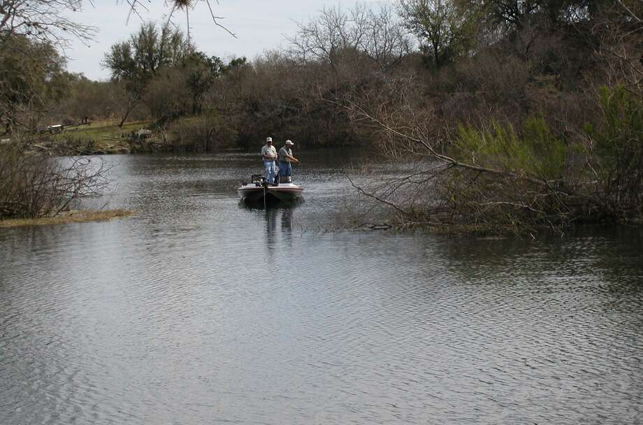 These anglers are out before the sun can bake them and fishing the shallow cover for black bass. Photo: Larry J. LeBlanc