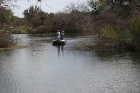 These anglers are out before the sun can bake them and fishing the shallow cover for black bass.