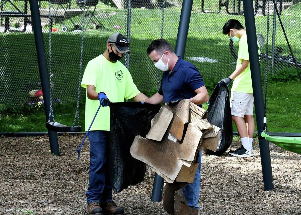 Albany County Legislature Chair Andrew Joyce joins workers with a new Albany County program to help clean up community parks and other areas throughout the County, as he helps to clean Elizabeth Street Park on Wednesday, Aug. 5, 2020, in Albany, N.Y. The Pride in Albany County Community Beautification Corps program is a part-time employment program for youth, ages 16-18. (Will Waldron/Times Union)