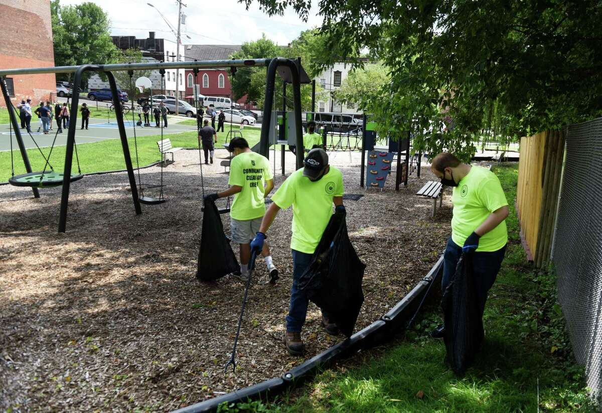Workers with a new Albany County program to help clean up community parks and other areas throughout the County clear trash form Elizabeth Street Park on Wednesday, Aug. 5, 2020, in Albany, N.Y. The Pride in Albany County Community Beautification Corps program is a part-time employment program for youth, ages 16-18. (Will Waldron/Times Union)
