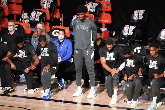 Orlando Magic player Jonathan Isaac stands during the national anthem before the team's recent game against the Sacramento Kings on Sunday. A reader supports Isaac's decision to stand, rather than kneel, during the anthem.