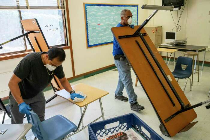 Custodians in California prepare a classroom for social distancing. But teachers unions have fought a return to campus. The catch is, online learning, especially for younger kids, is a poor substitute for being in the classroom.