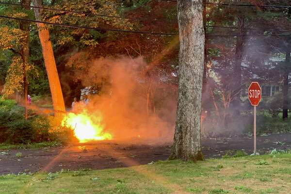 Wires burn on Birch and Point o' Woods Road on Tuesday, August 4, 2020. A neighbor captured this moment during the height of Tuesday's storm.