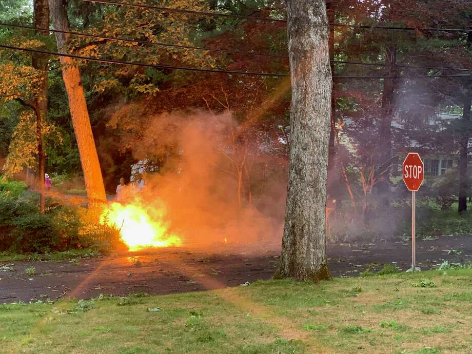 Wires burn on Birch and Point o' Woods Road on Tuesday, August 4, 2020. Thousands were without power and tons of wires and trees fell during the height of the storm. Taken in Darien, Connecticut. Wires burn on Birch and Point o' Woods Road on Tuesday, August 4, 2020. Thousands were without power and tons of wires and trees fell during the height of the storm. Taken in Darien, Connecticut. Photo: Contributed Photo / Contributed / Darien Times