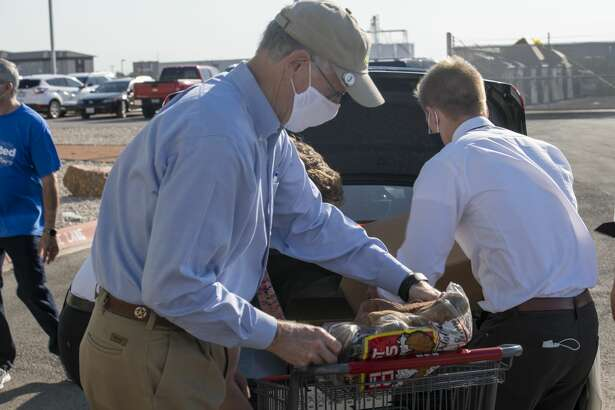 Congressman Mike Conaway (R-Midland) helps distribute food boxes Wednesday, Aug. 5, 2020 at the West Texas Food Bank in Odessa. Jacy Lewis/Reporter-Telegram