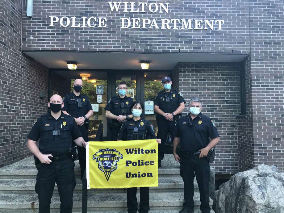 Several members of the Wilton Police Union stand in front of the police station. Back row from left, William Whitman (new recruit), Ofc. Graham O'Connor, Ofc. Sean Baranowski. Front row from left, Ofc. Frank Razzaia (union vice president), Sgt. Anna Tornello (union president), and Ofc. Robert Nosal. Photo: Sgt. Anthony Cocco Photo