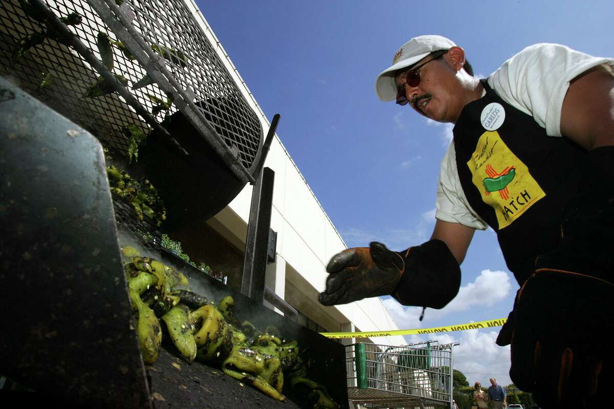 Carlos Torrez roasts Hatch chiles at Central Market in 2006.