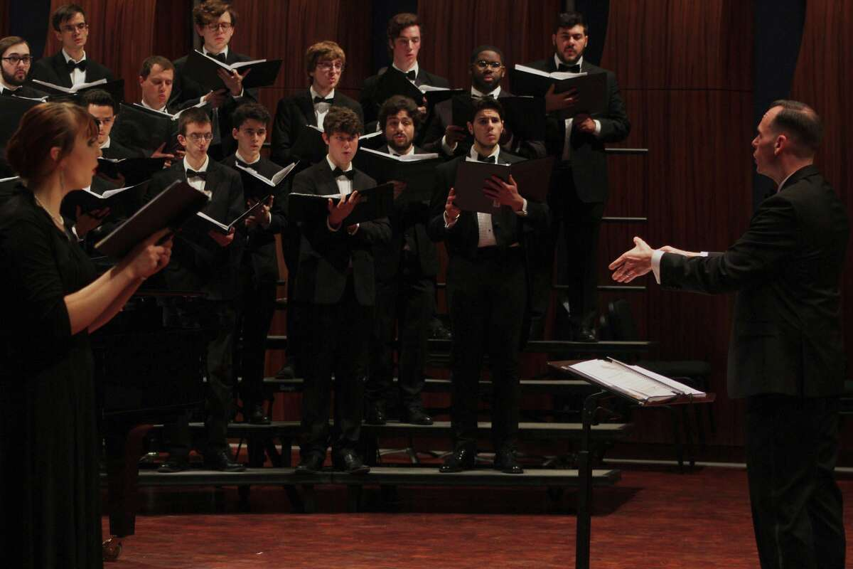 Jeremy Wiggins, an assistant professor of music at Western Connecticut State University, conducts students in the Concert Chorale before the coronavirus pandemic.