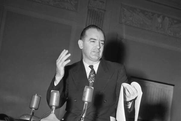 Sen. Joseph R. McCarthy stands by the tape recorder that caused all the row at the pretrial hearing of his slander suit against Connecticut Sen. William Benton