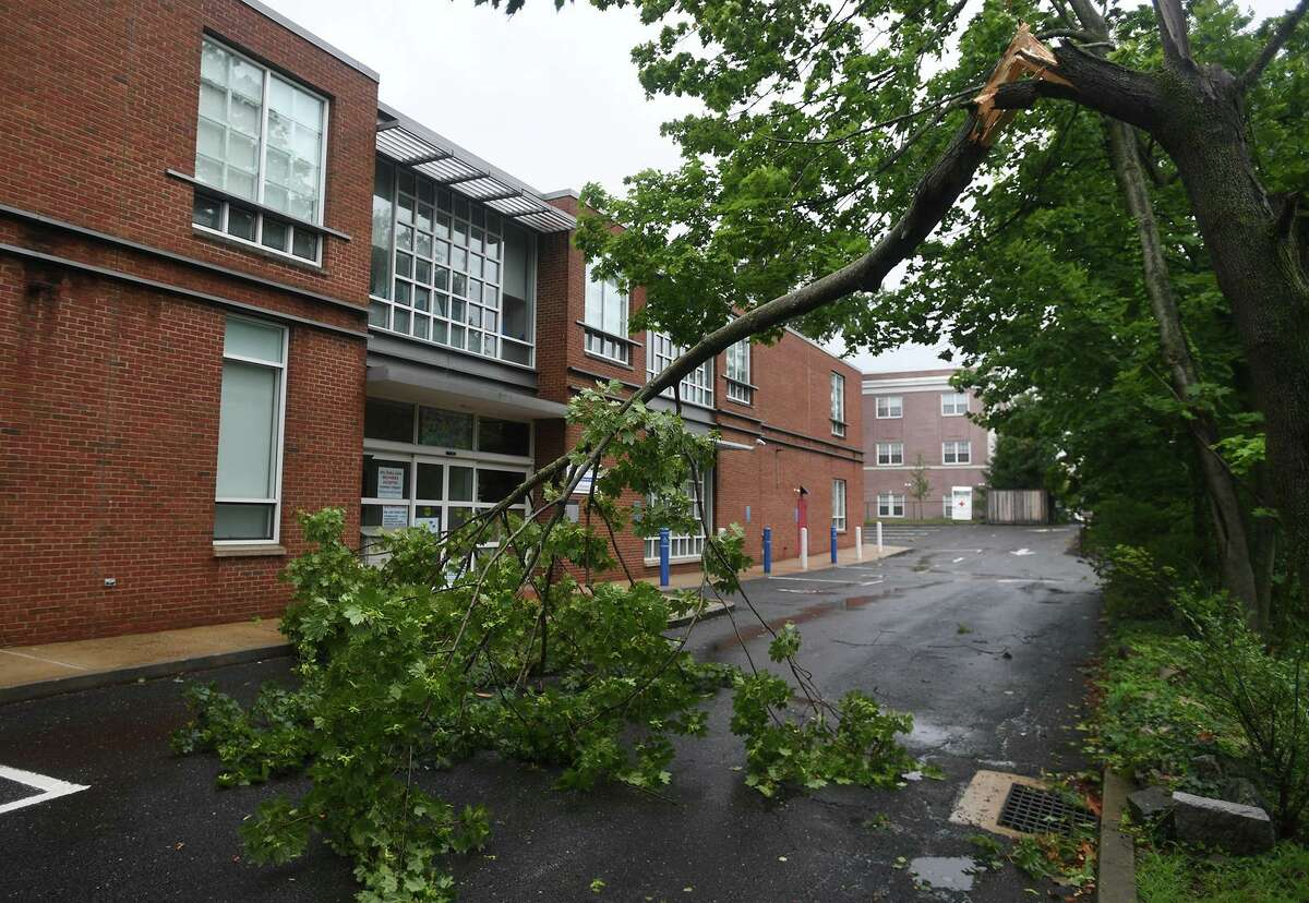 A downed tree limb blocks the driveway to the Fairfield Library as Tropical Storm Isaias brings high winds to Fairfield, Conn. on Tuesday, August 4, 2020.
