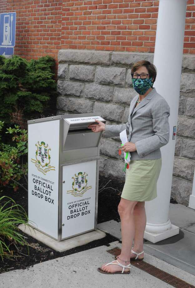 Town Clerk Wendy Lionetti advises voters to use the official ballot drop box by the Bailey Avenue entrance to town hall, rather than mail back absentee ballots and risk having them come in too late. Photo: Macklin Reid / Hearst Connecticut Media