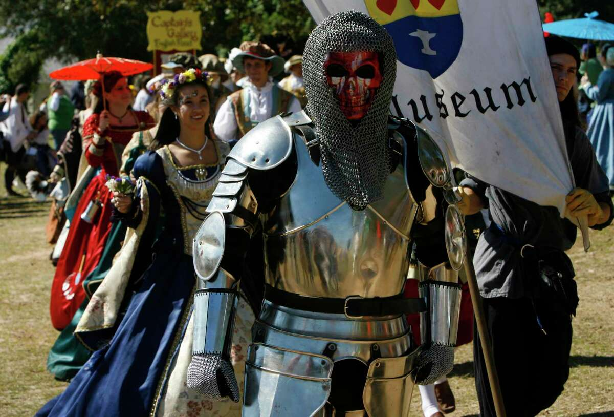 During the Grand Marche Parade (cq) , a cast of characters weave their way though the Texas Renaissance Festival ground Saturday, Oct. 27, 2007, in Planterville. ( Melissa Phillip / Chronicle )
