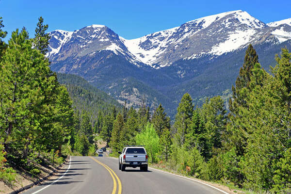 As national parks like Colorado's Rocky Mountain reopen, vacationers are flocking there even though timed entry reservations are now required.