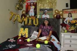 Nyomi Moncivias signed with Texas A&M International Saturday to continue her softball career.