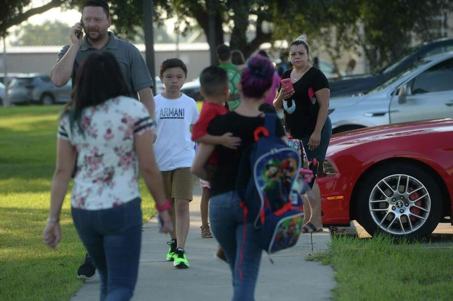 Families and students make their way to Bridge City Elementary Monday morning as students throughout the district head back to school. BCISD is the first district in the region to begin the 2020-21 school year. Photo taken Monday, August 3, 2020 Kim Brent/The Enterprise Photo: Kim Brent / The Enterprise / BEN