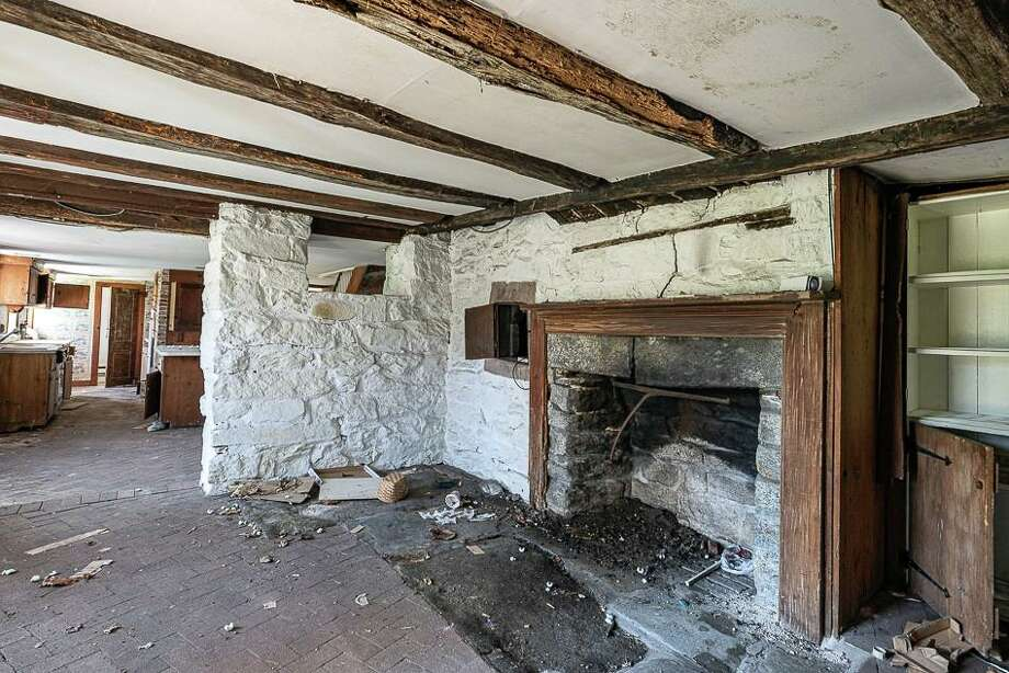 The most remarkable find, according to architect Duo Dickinson, was what the group believes to be an 18th century center hall fireplace in the basement, which show's the structure's earlier construction. The fireplace still has its original hearth and bread oven. Photo: Tod Bryant /
