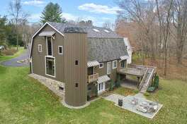 This house features an authenic silo, raised wood deck and a balcony.