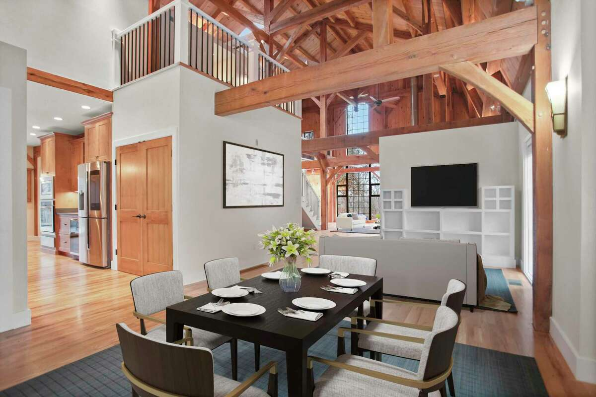 The living and dining rooms share one large, open space. The living room also has built-in shelving. (virtually staged)