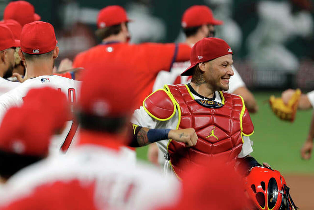 Cardinals catcher Yadier Molina (right) celebrates a July 24 win over the Pittsburgh Pirates at Busch Stadium.