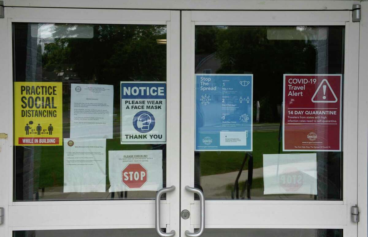 Signs at the municipal center in Bethel, Conn, the site of a charging station, Wednesday, August 5, 2020.