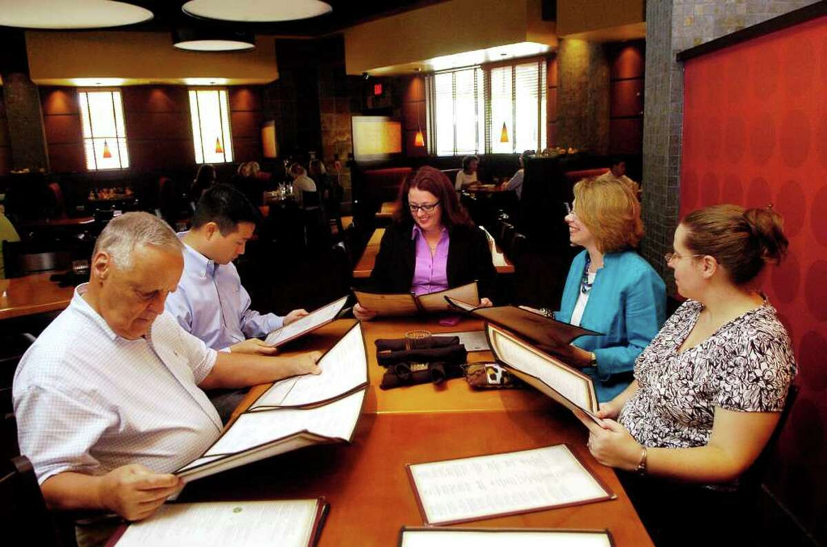 Attorney Frances Slusarz, at the head of the table, and coworkers, clockwise Dick Rose, Brian Song, Regina Flaherty and Katie Joseppsen take time to for a real lunch at PF Changs in Stamford, Conn. on Thursday August 26, 2010.