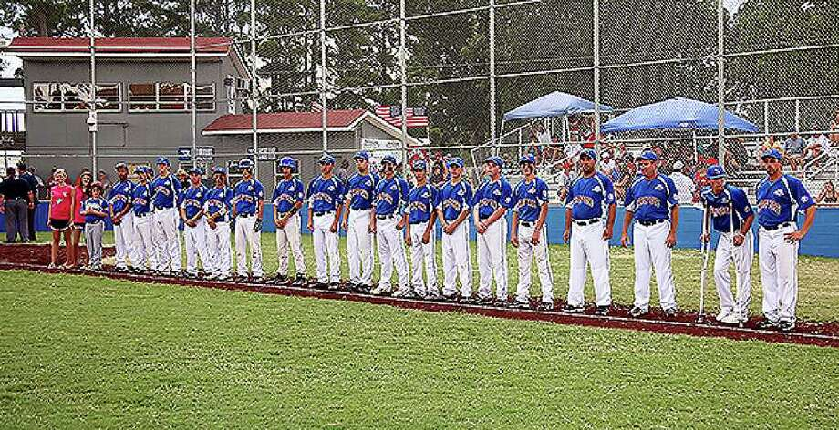 Stamford players and coaches line up for the start of the Babe Ruth World Series game at Burlington Field in Monticello, Arkansa on Sunday August 22, 2010. The game went into a rian delay before the first pitch was thrown. Photo: Mike Adam