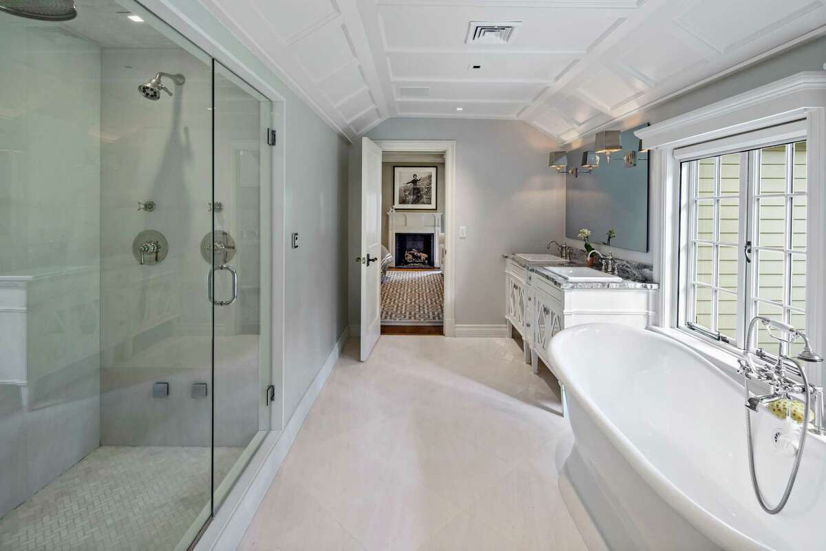 The luxurious master bath has a double vanity, glass shower and soaking tub.