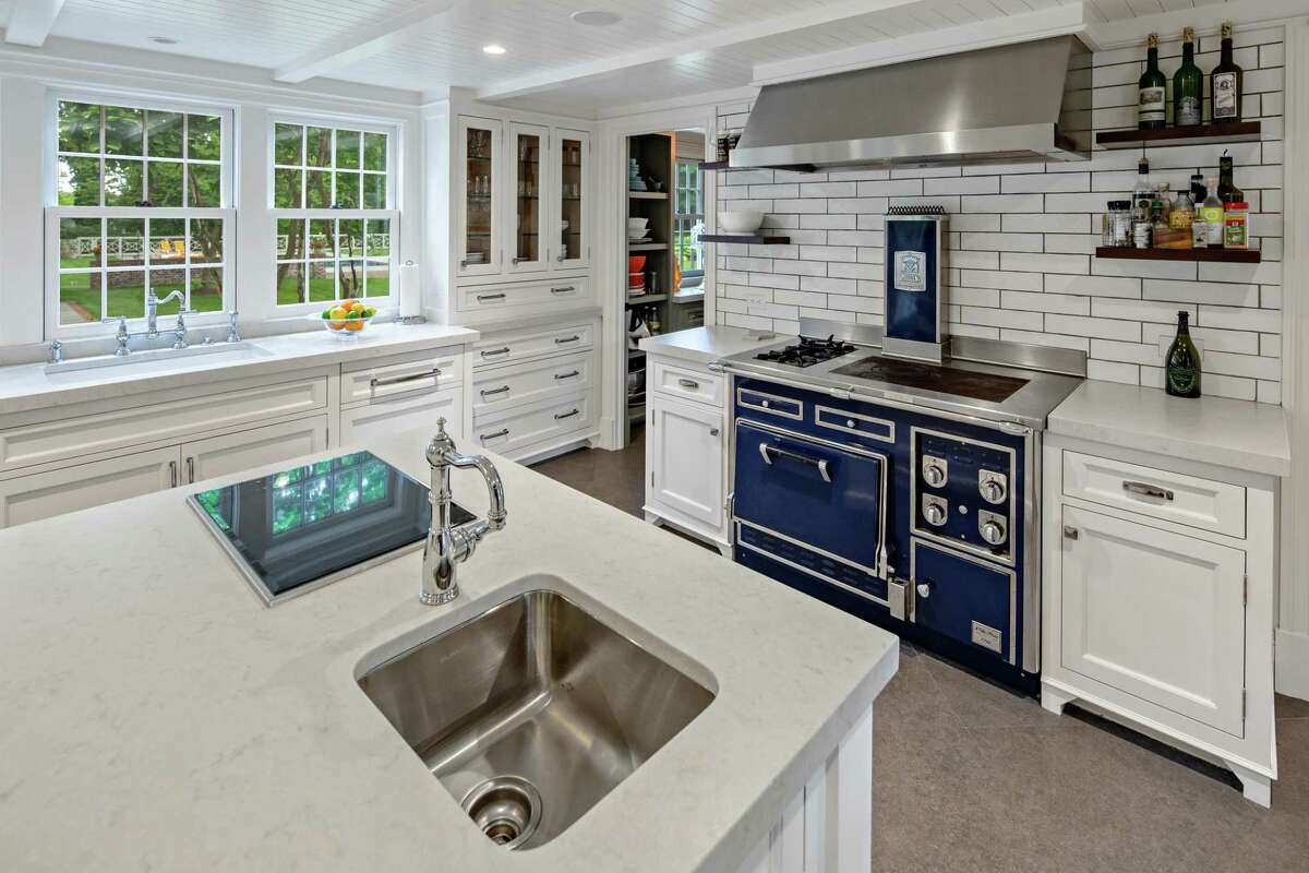 In the gourmet kitchen there is a large center island/breakfast bar, quartzite counters, and high-end appliances including an imported French Molteni range. Despite its central and convenient location this is a private setting. The house sits on a 3.73-acre level and partially fenced corner lot diagonally across from the Wilton Congregational Church. In fact, the driving directions point out the red mailbox in front of the church to help find the driveway for this address across from it. From there