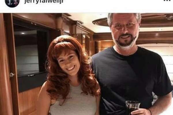 """Jerry Falwell Jr., president of the Christian and conservative Liberty University in Lynchburg, Va., posted this photo on social media Sunday, Aug. 2, 2020, with the caption: """"More vacation shots. Lots of good friends visited us on the yacht. I promise that's just black water in my glass. It was a prop only."""""""